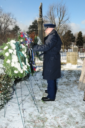 New York Air National Guard Col. Kevin Rogers places a wreath from President Barack Obama at the gravesite of President Millard Fillmore on Jan. 7, 2015. (Photo by Tech Sgt. Brandy Fowler, 107th AW)
