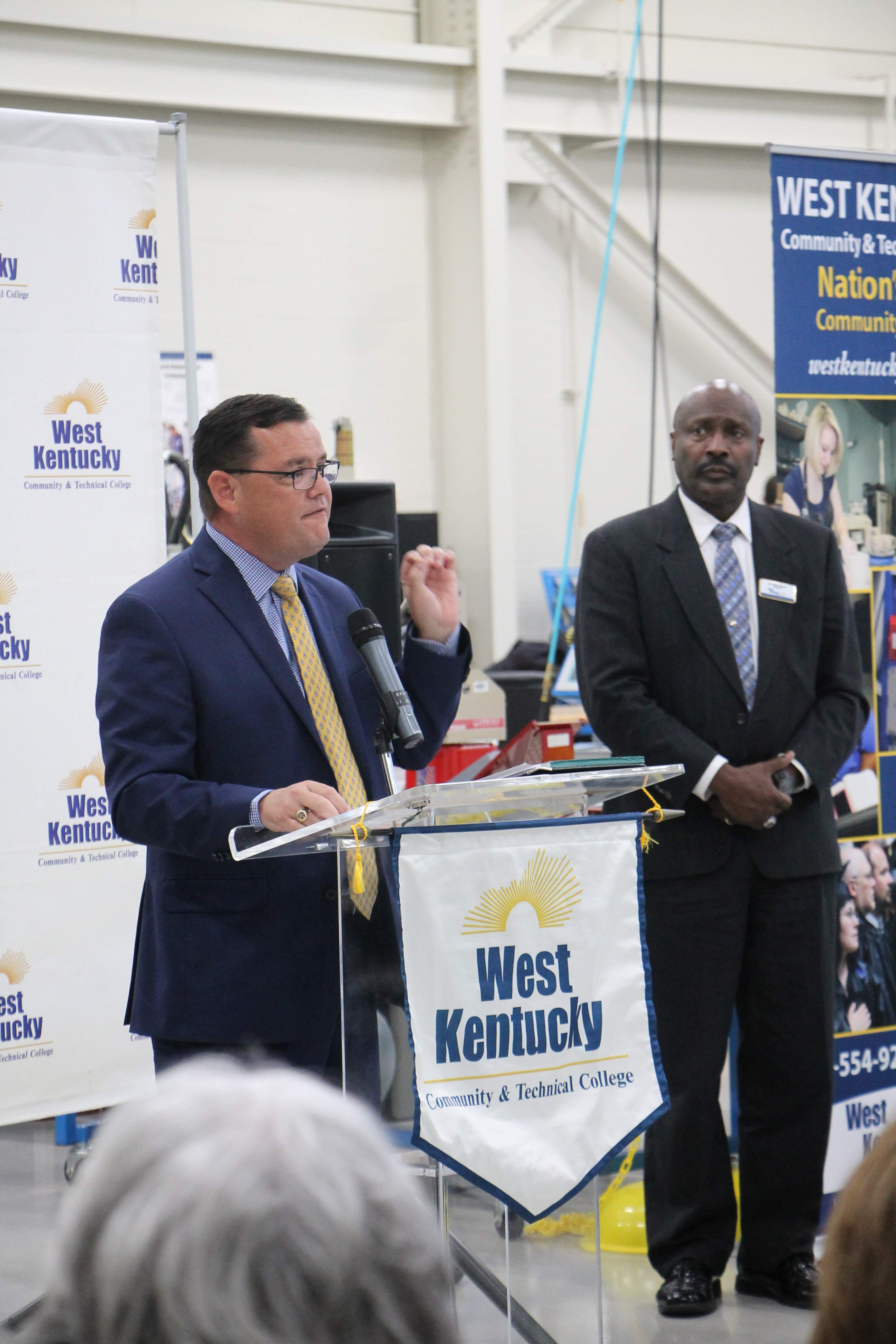 Fulton County Schools Superintendent Aaron Collins speaks before a  ceremonial agreement signing for the Work Ready Skills Initiative Grant at  WKCTC October ...