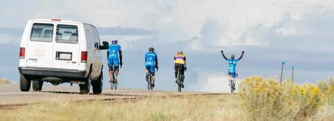 4 cyclists hands up 2014