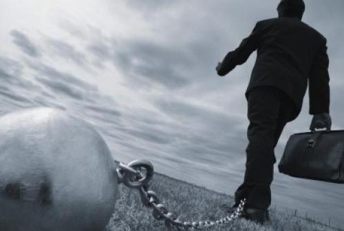 Man walking with ball and chain thinkstockphotos 77870170