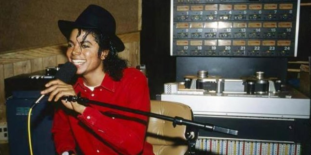 Mj sitting behind mic