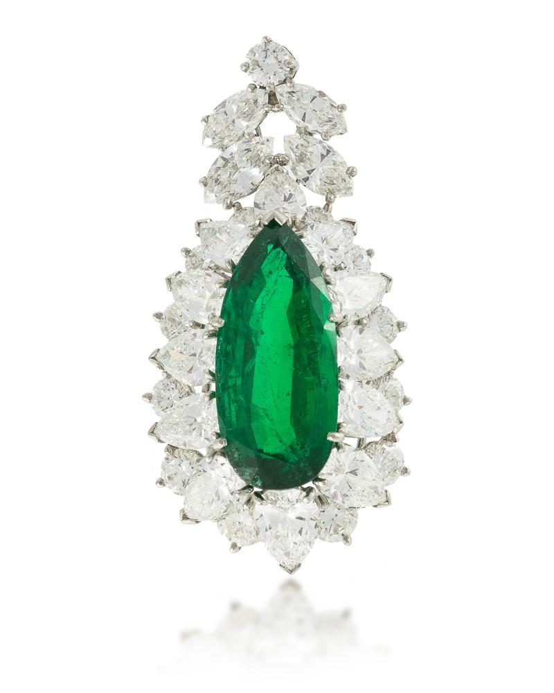 Lot 1070: A Colombian emerald and diamond pendant Image