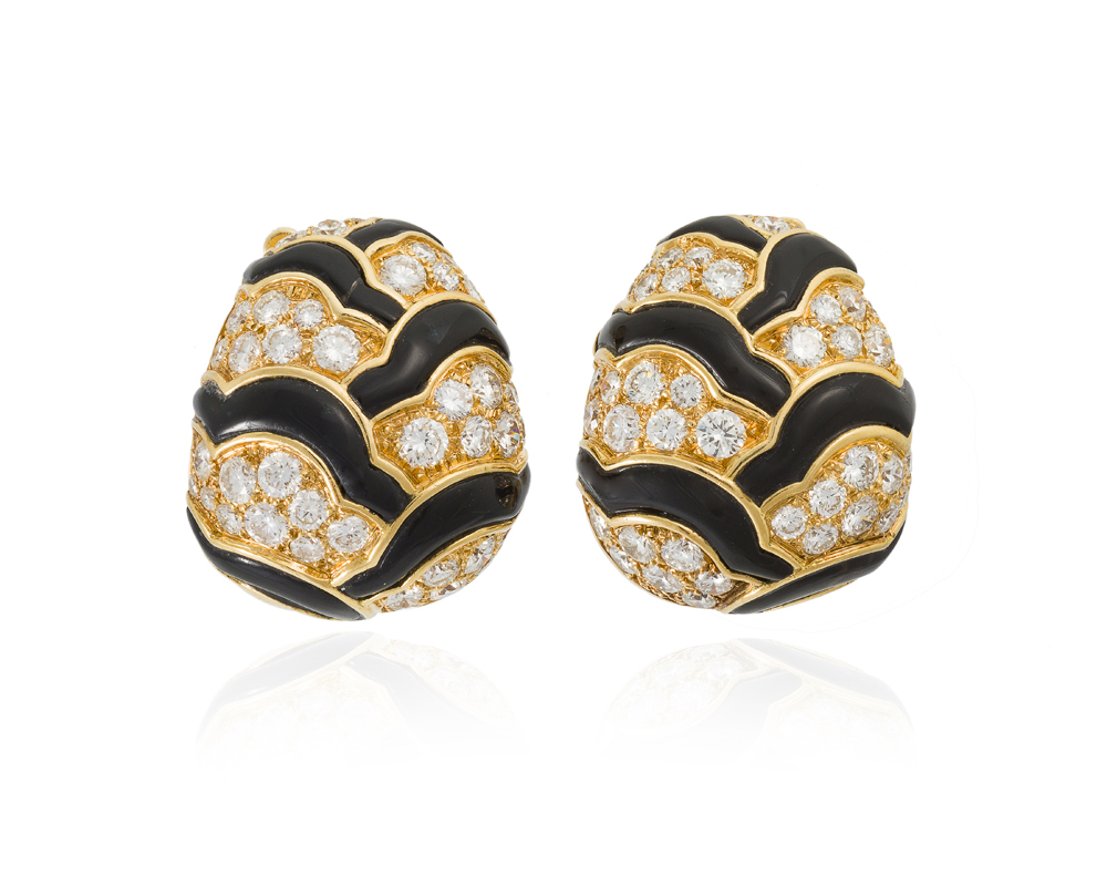 Lot 1171: A pair of onyx and diamond ear clips, Van Cleef & Arpels Image