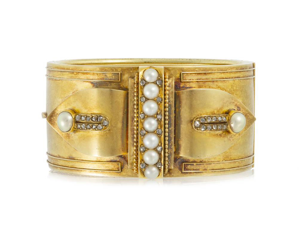 Lot 1002: A Victorian pearl and diamond hinged bangle Image