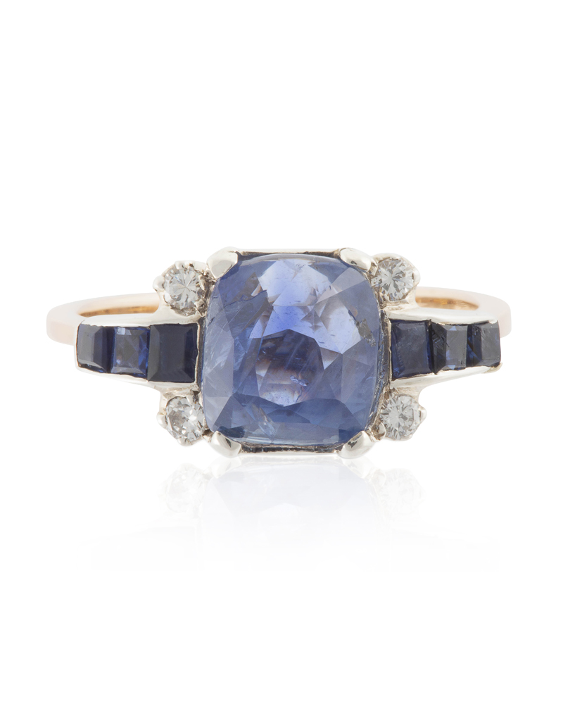 Lot 1014: A sapphire and diamond ring Image