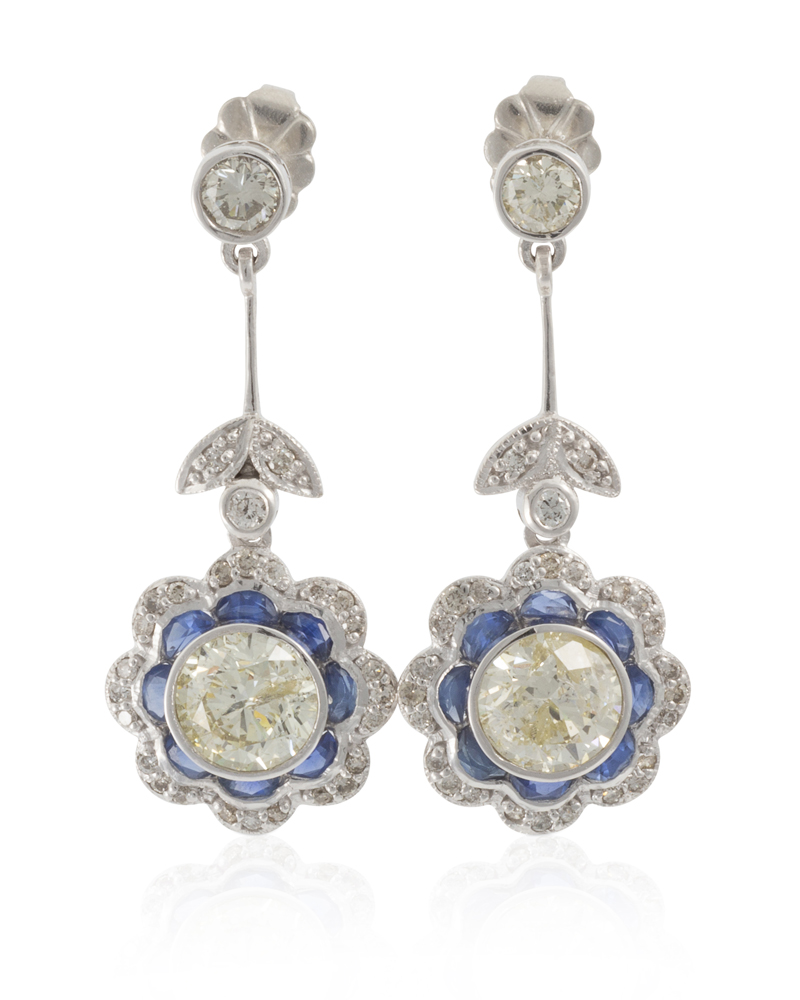 Lot 1017: A pair of diamond and sapphire earrings Image
