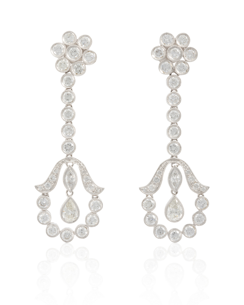 Lot 1019: A pair of diamond earrings Image