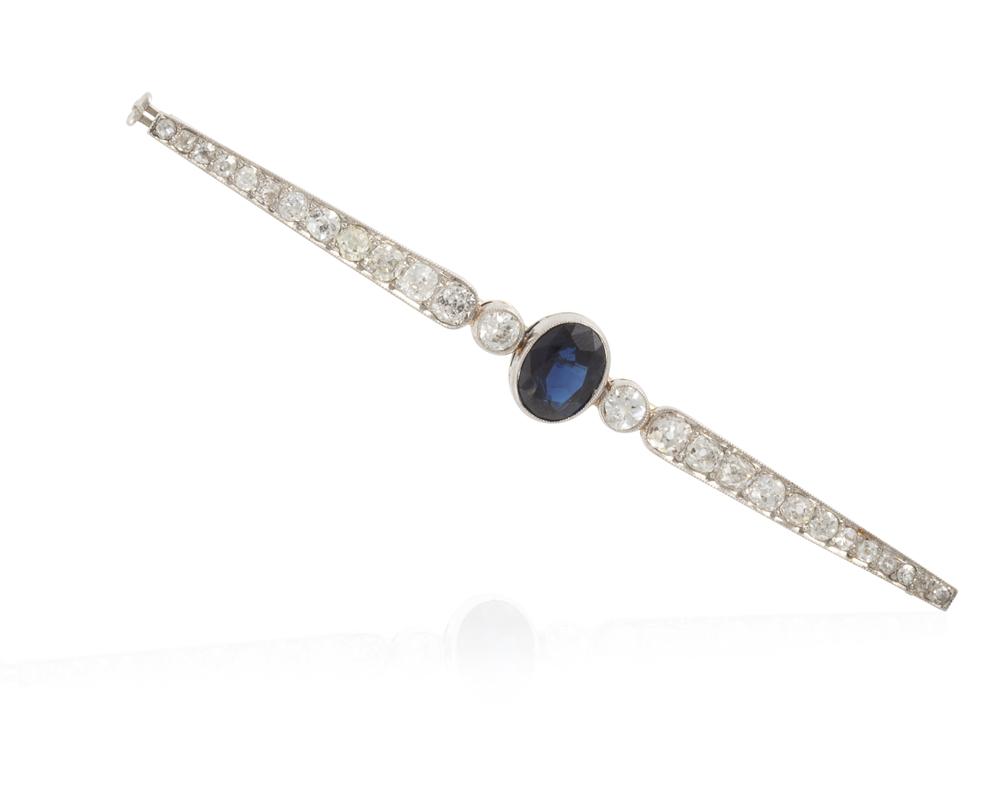 Lot 1022: An Art Deco sapphire and diamond bar brooch Image