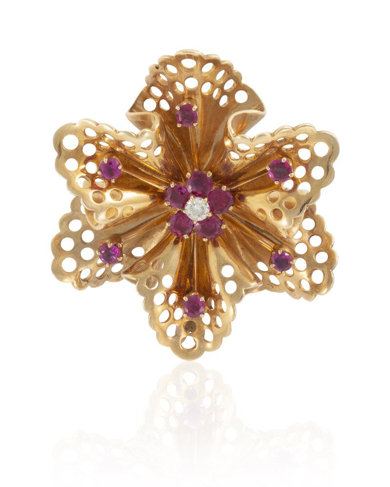 Lot 1033: A Retro ruby and diamond flower pendant/brooch Image