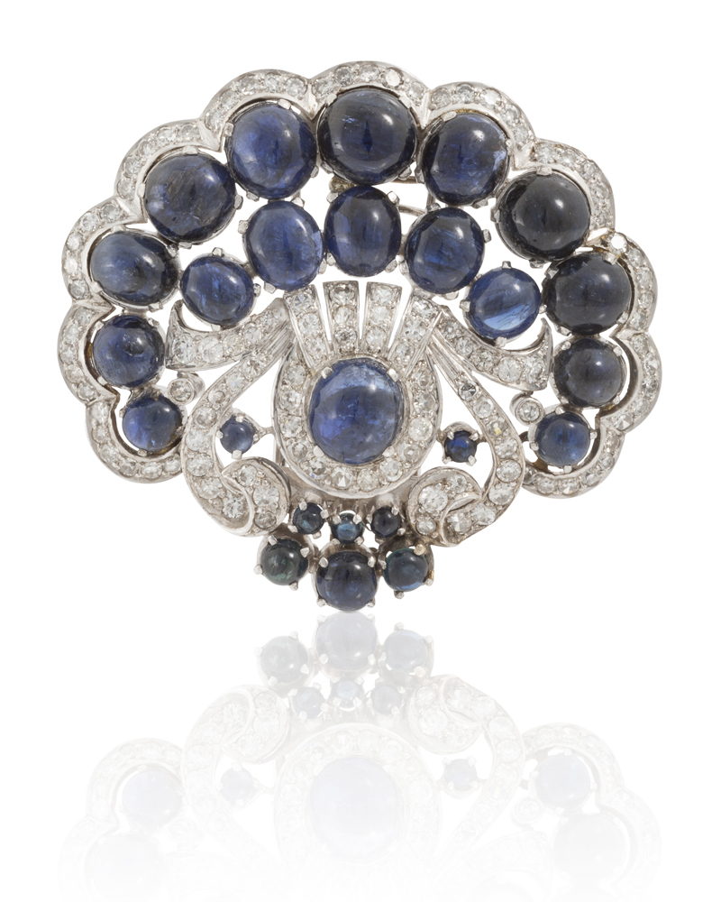 Lot 1039: A cabochon sapphire and diamond brooch Image
