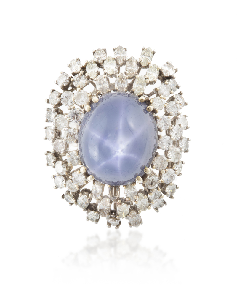 Lot 1044: A star sapphire and diamond ring Image