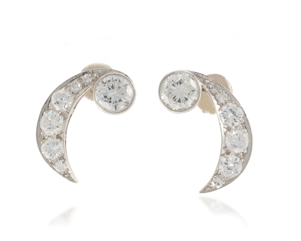Lot 1045: A pair of diamond earrings Image