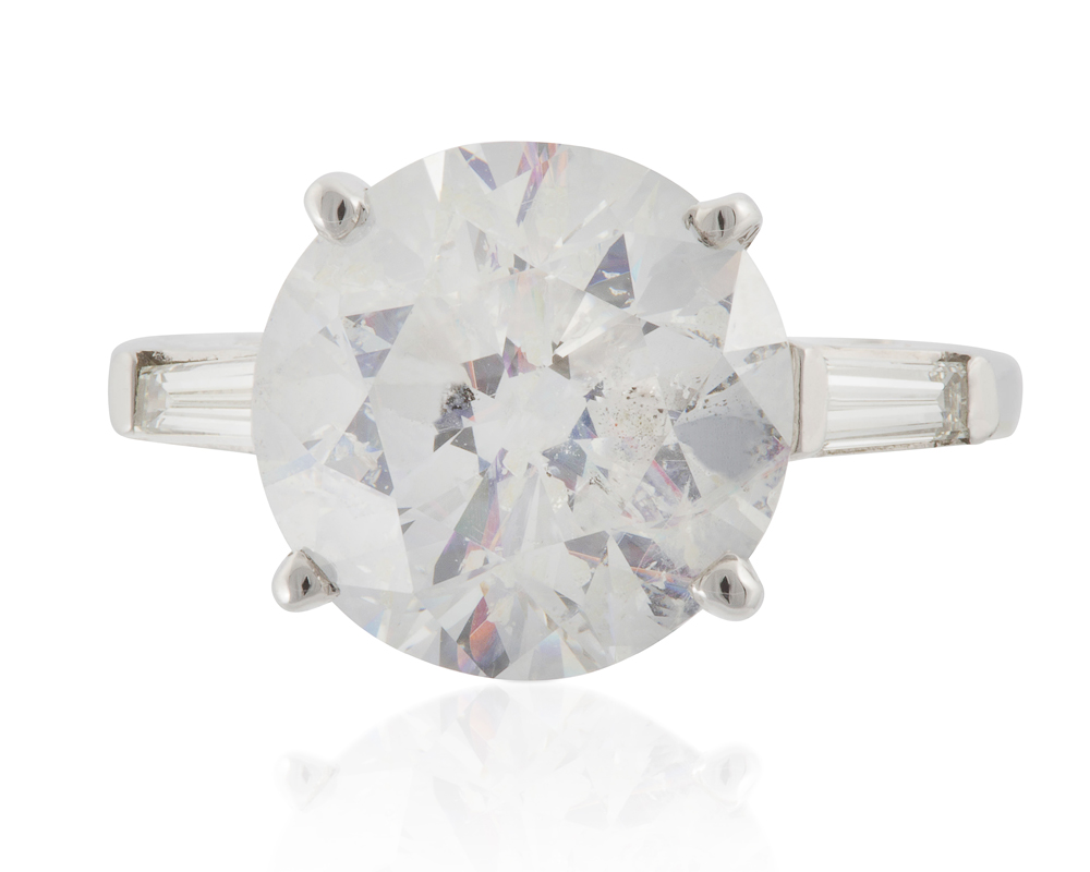 Lot 1046: A laser drilled diamond ring Image