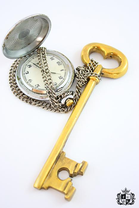 Pocket watch and skeleton key.