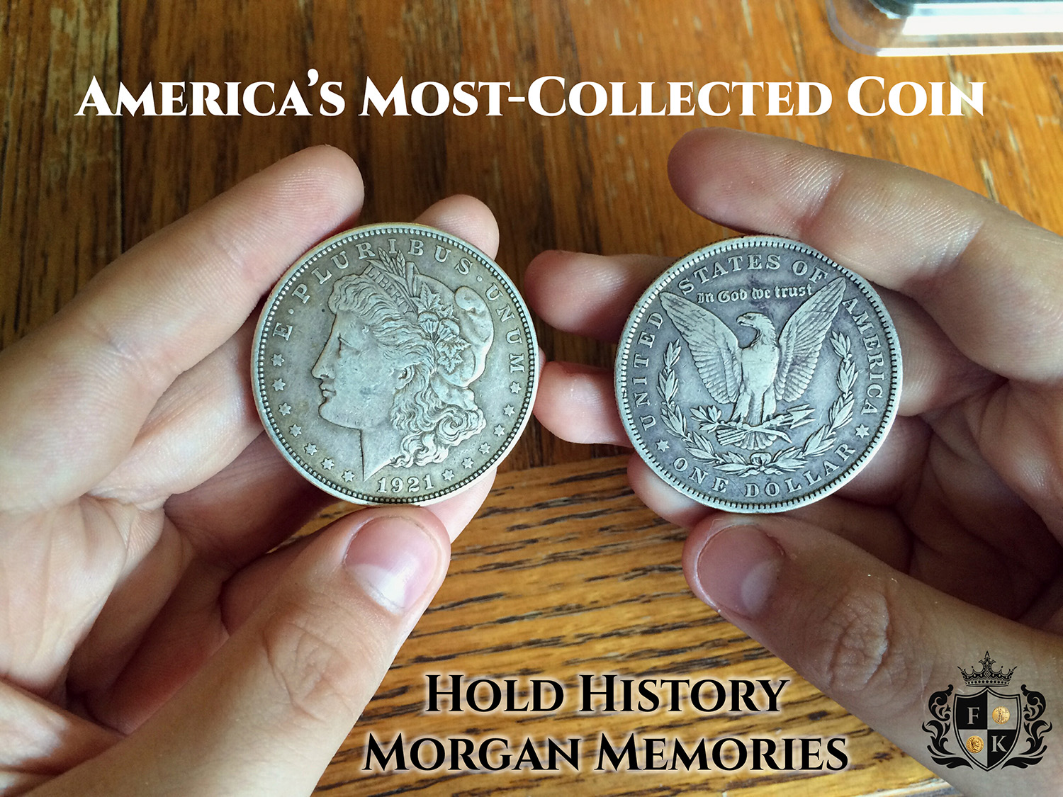 Holding two old silver dollars in hands