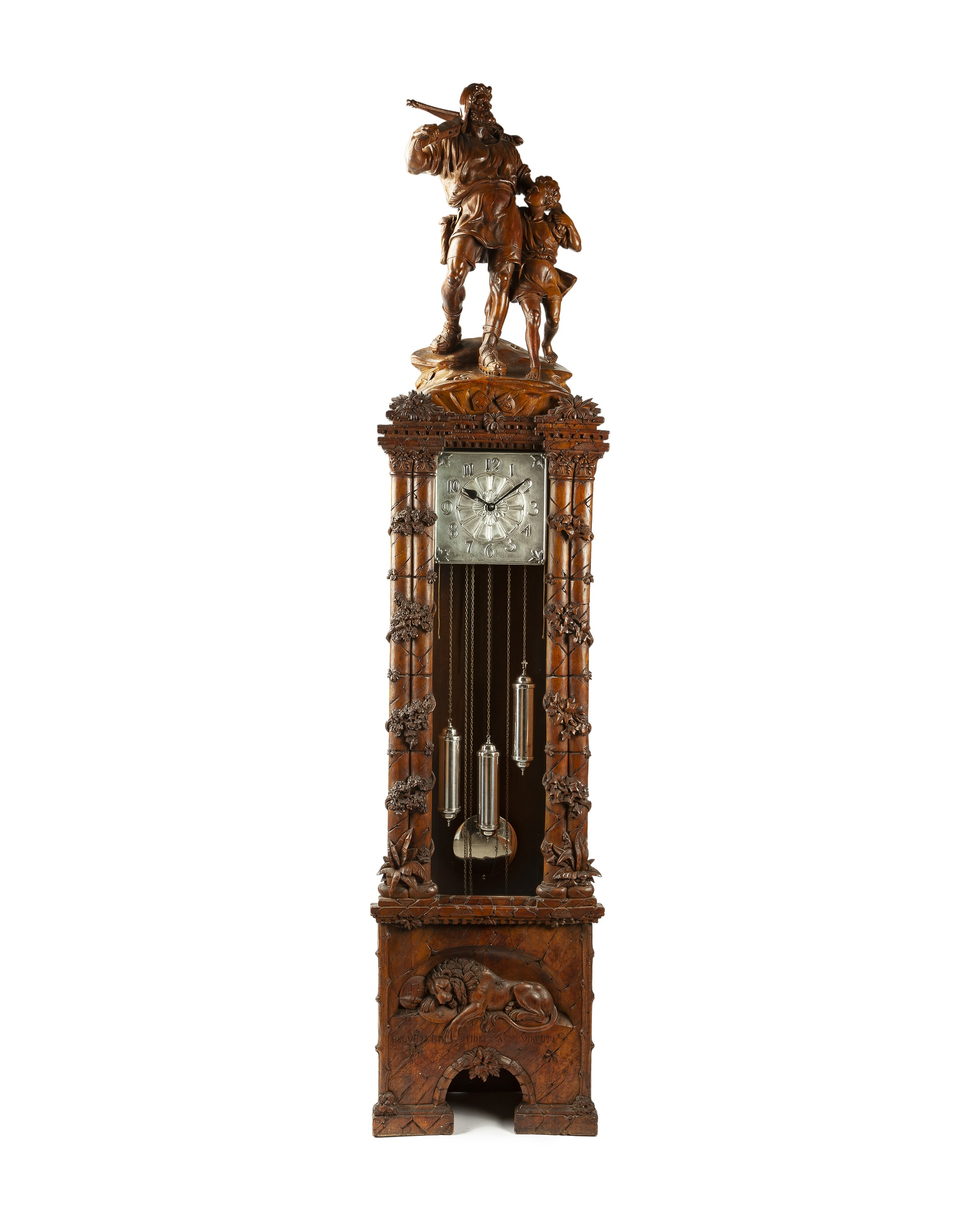 A Swiss carved linden wood tall case clock