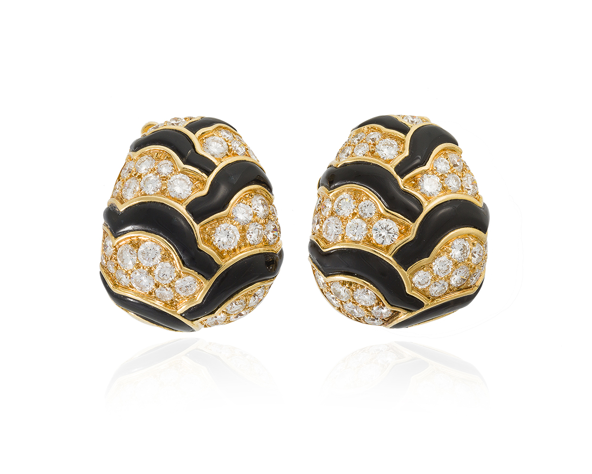 A pair of onyx and diamond ear clips, Van Cleef & Arpels