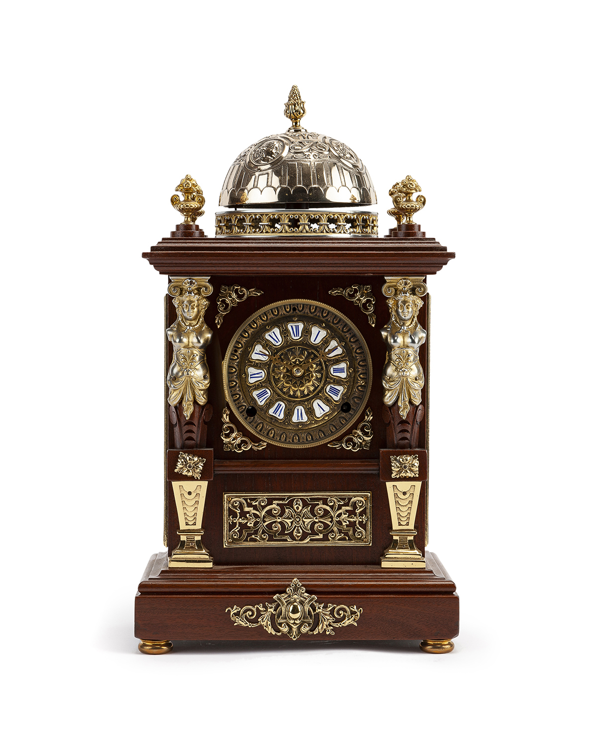 A gilt bronze-mounted mantel clock