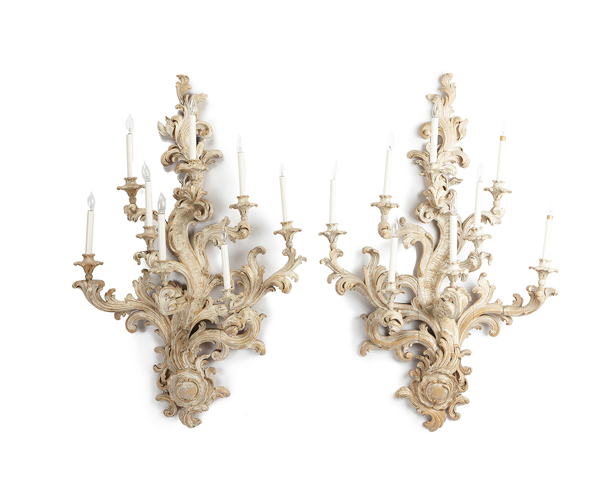 A pair of carved candle sconces
