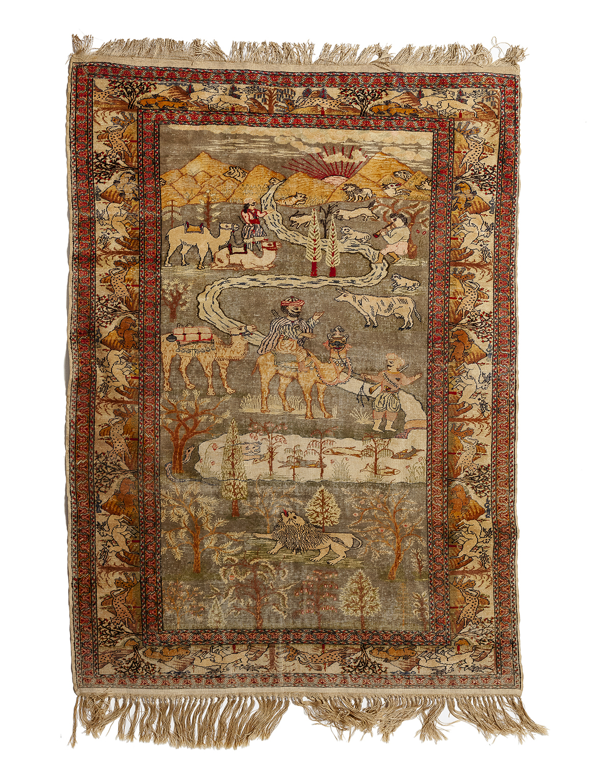 A silk rug with figural motifs