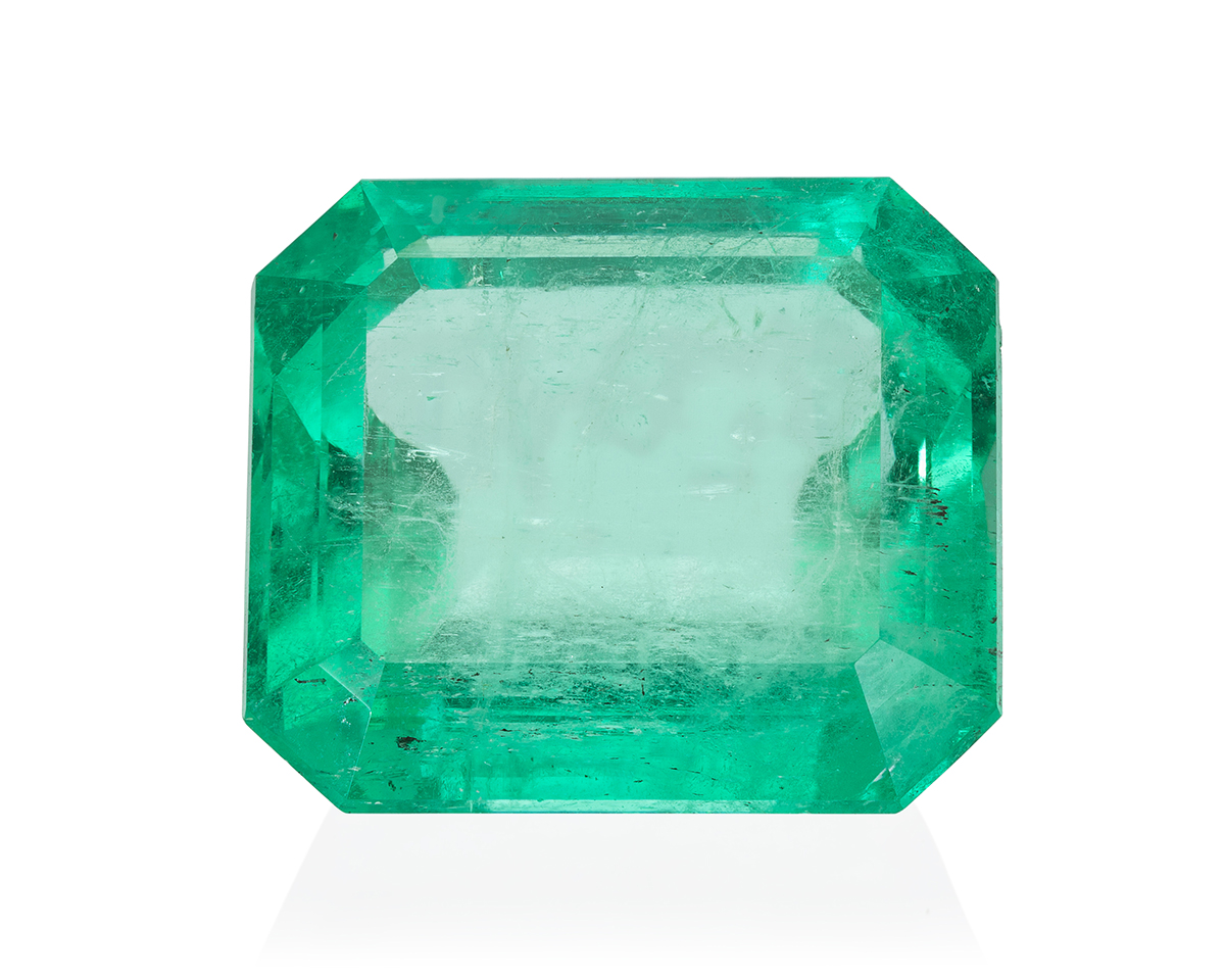 An unmounted rectangular-cut emerald