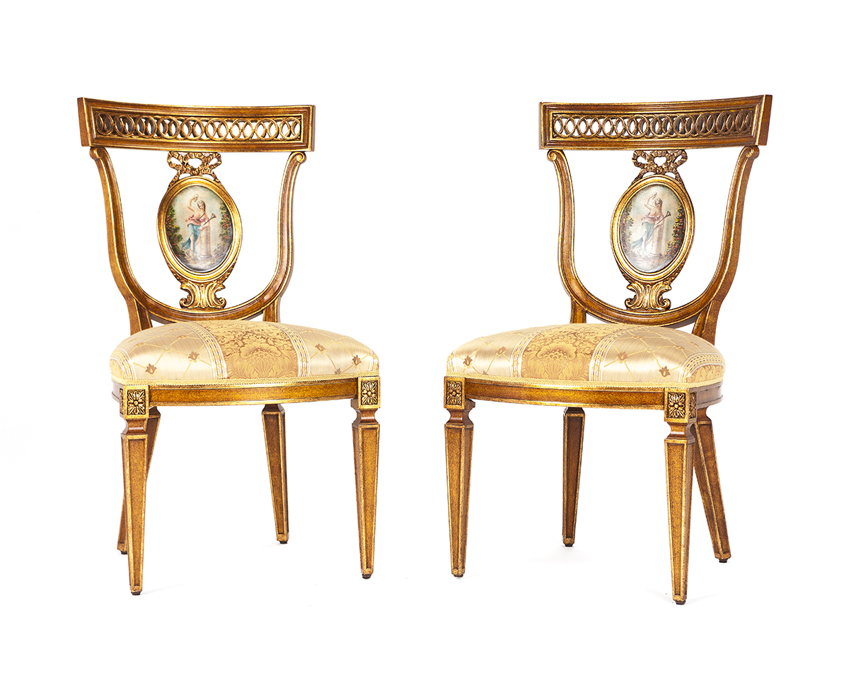 Eight French-style gilt and painted dining chairs