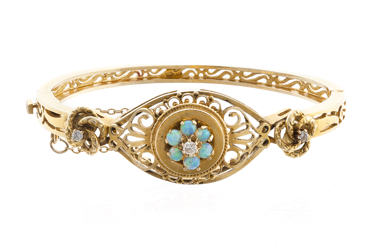 An opal and diamond hinged bangle bracelet