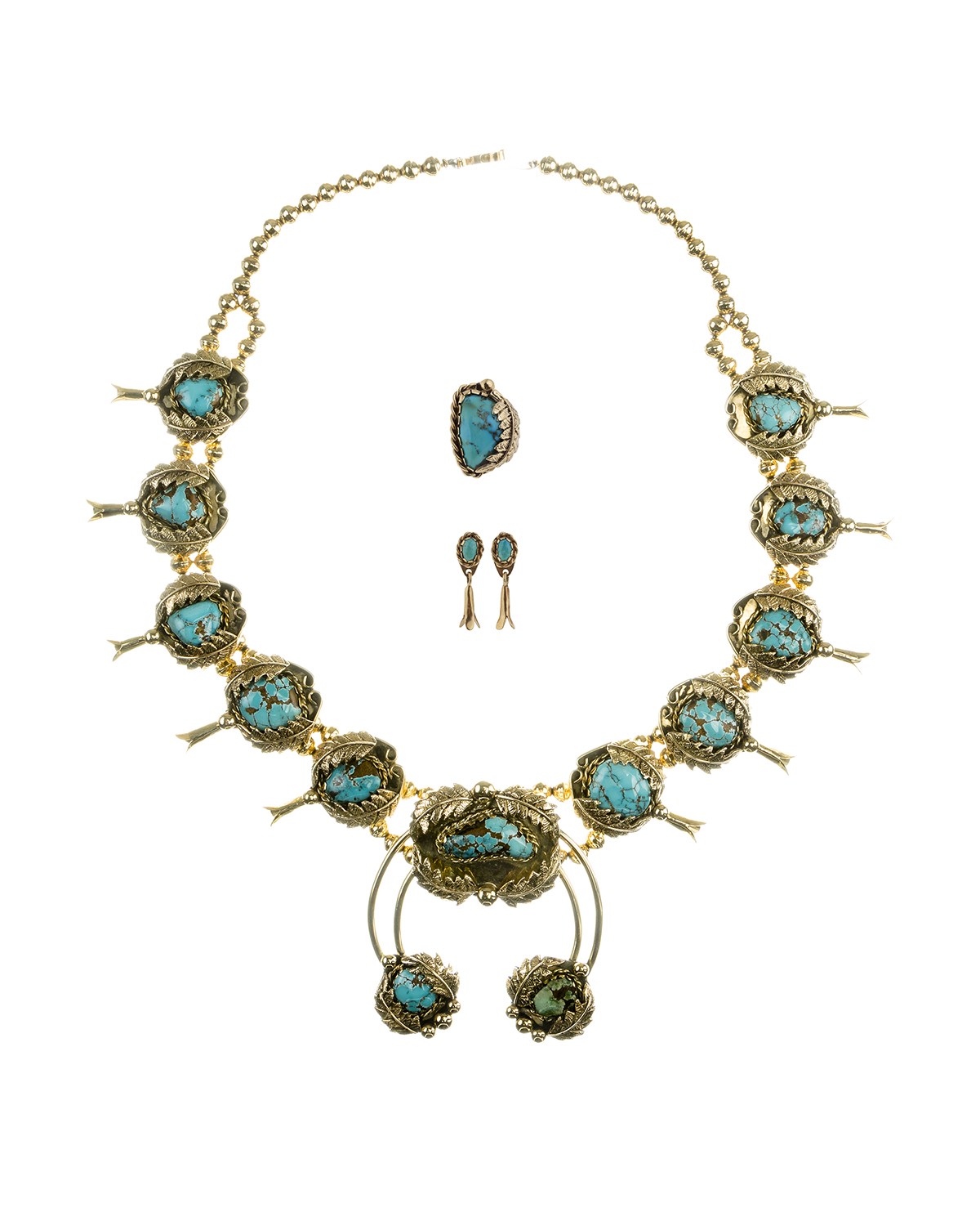A Navajo-style gold and turquoise squash blossom suite
