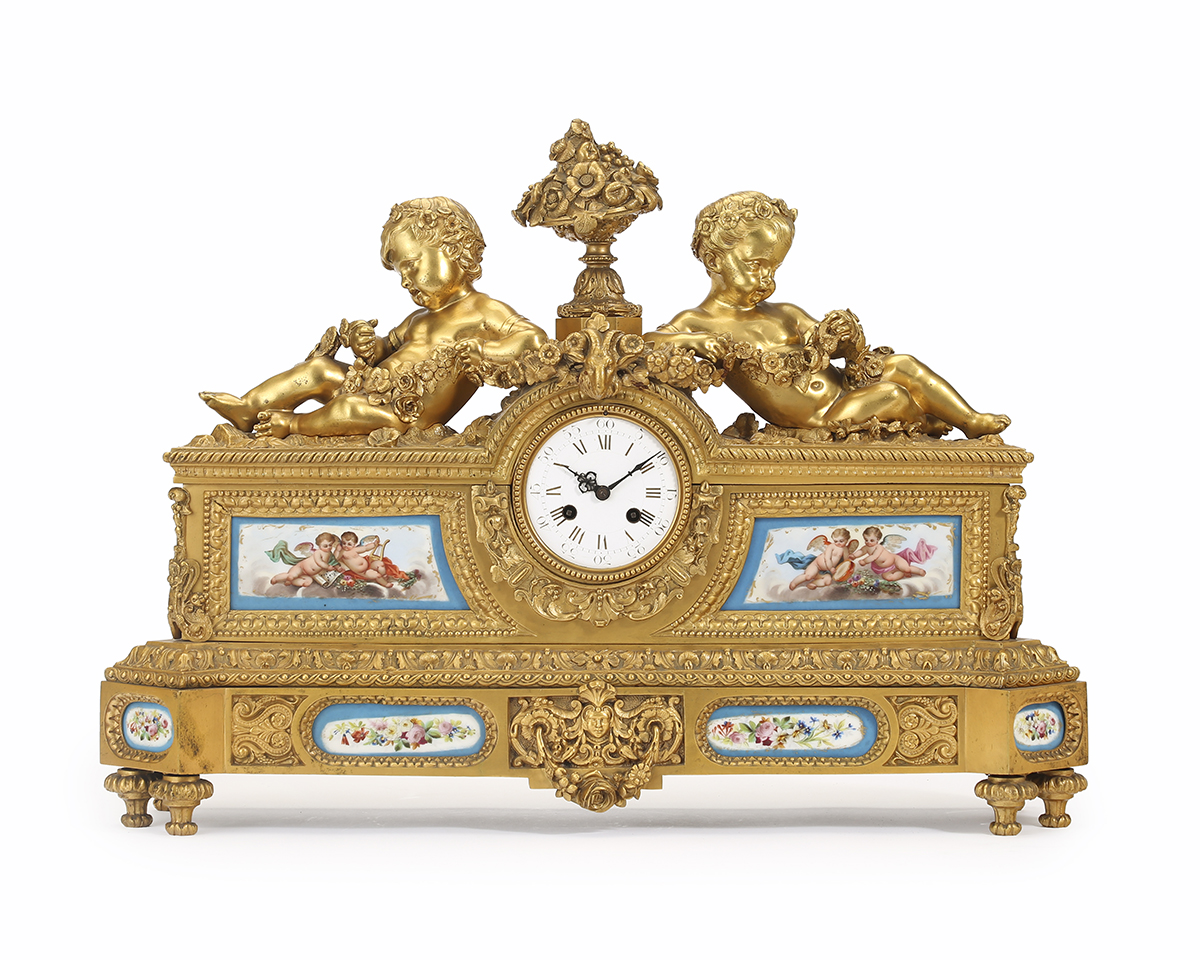 A Louis XVI-style gilt-bronze and porcelain mantel clock