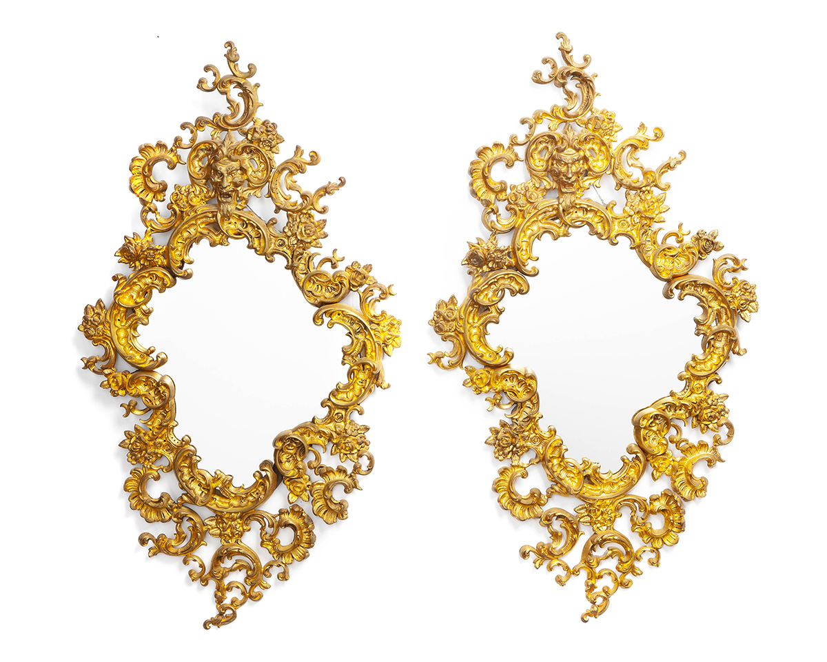 A pair of French gilt-bronze wall mirrors