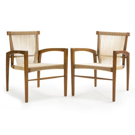 A pair of vintage teak and cord chairs