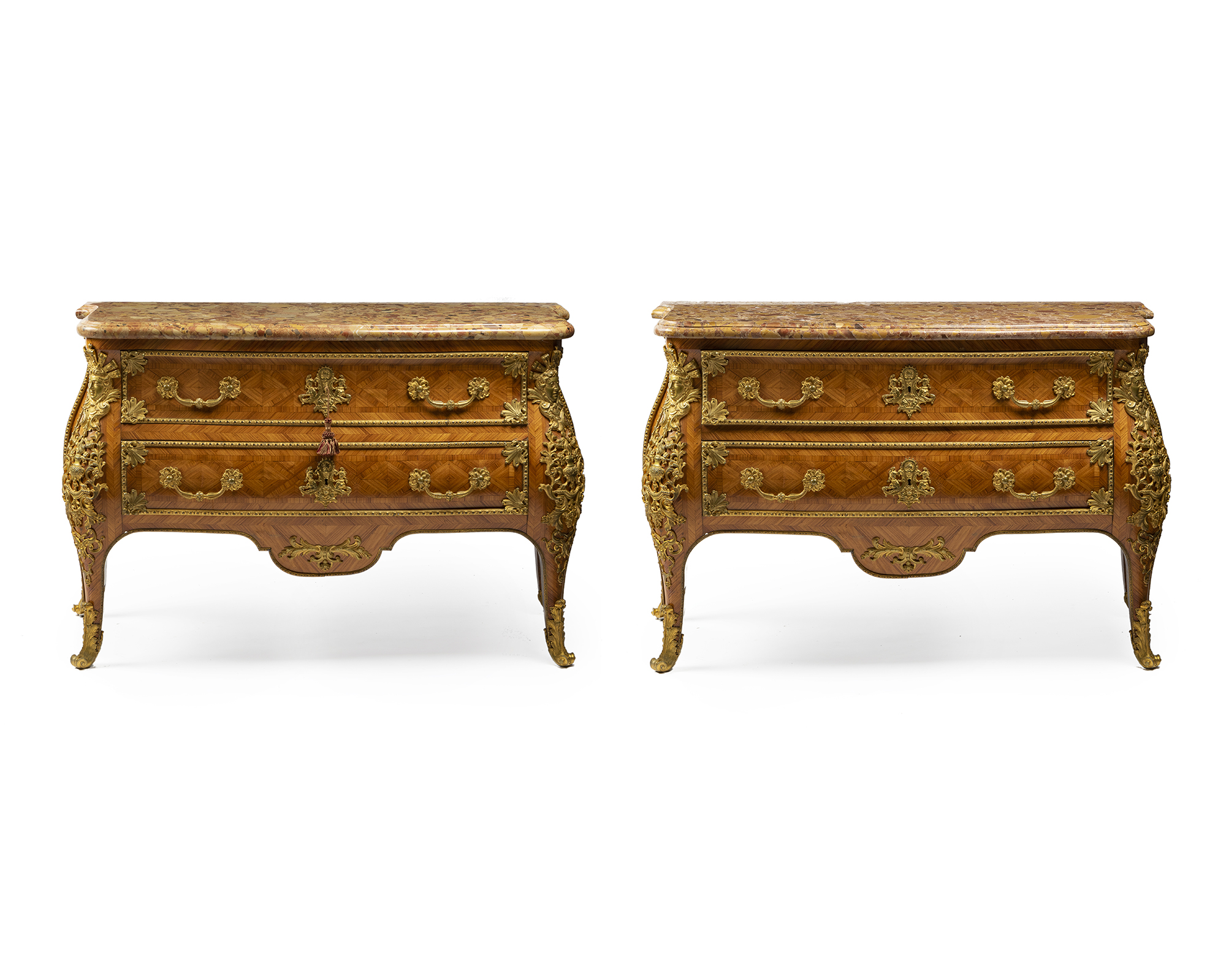 A pair of gilt bronze-mounted kingwood parquetry commodes en tombeau, est: $5000-7000