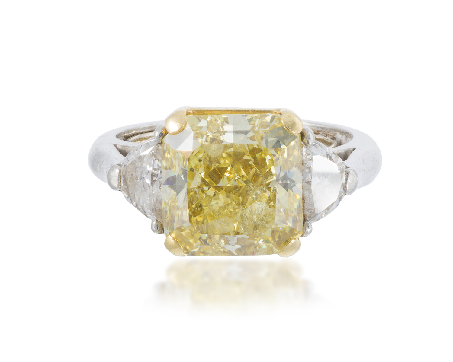 A Fancy Intense Yellow And Near Colorless Diamond Ring