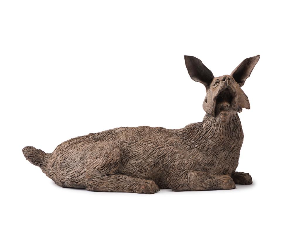A ceramic anthropomorphic jackal