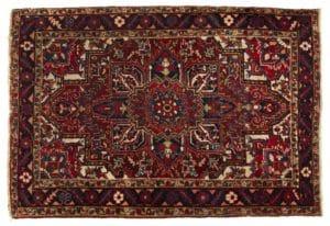 Lot# 1014, A small Heriz area rug, est: $500-700