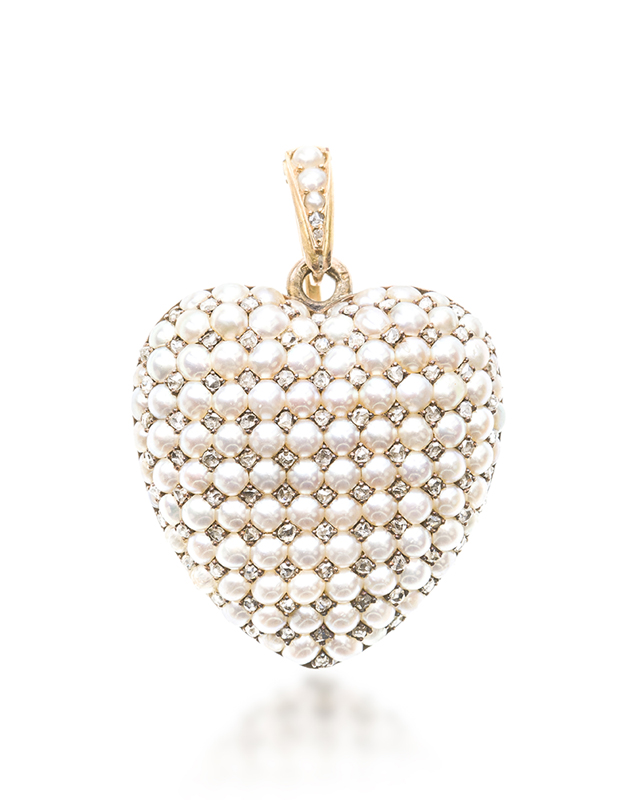 A Victorian pearl and diamond heart pendant locket