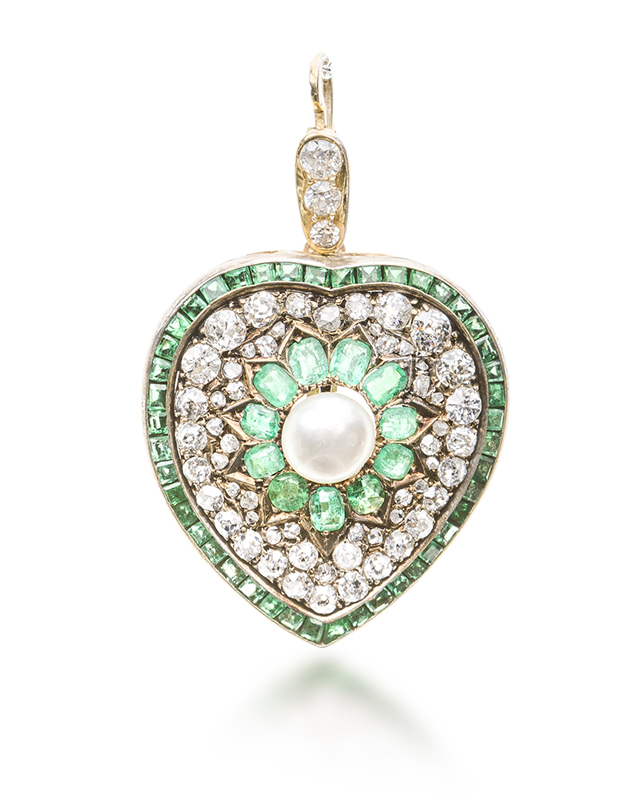 An Edwardian diamond, pearl, and emerald heart pendant