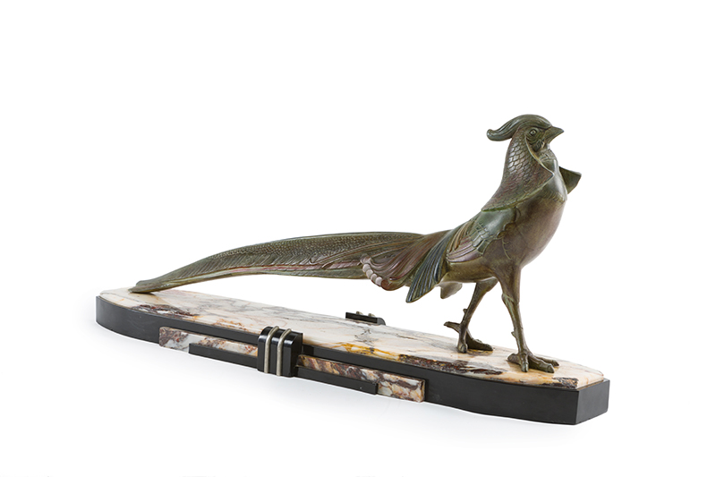 An Art Deco patinated metal Phoenix bird on marble