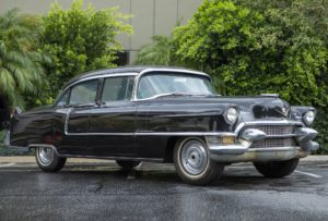 A 1955 Cadillac four-door sedan, price realized: $5,625