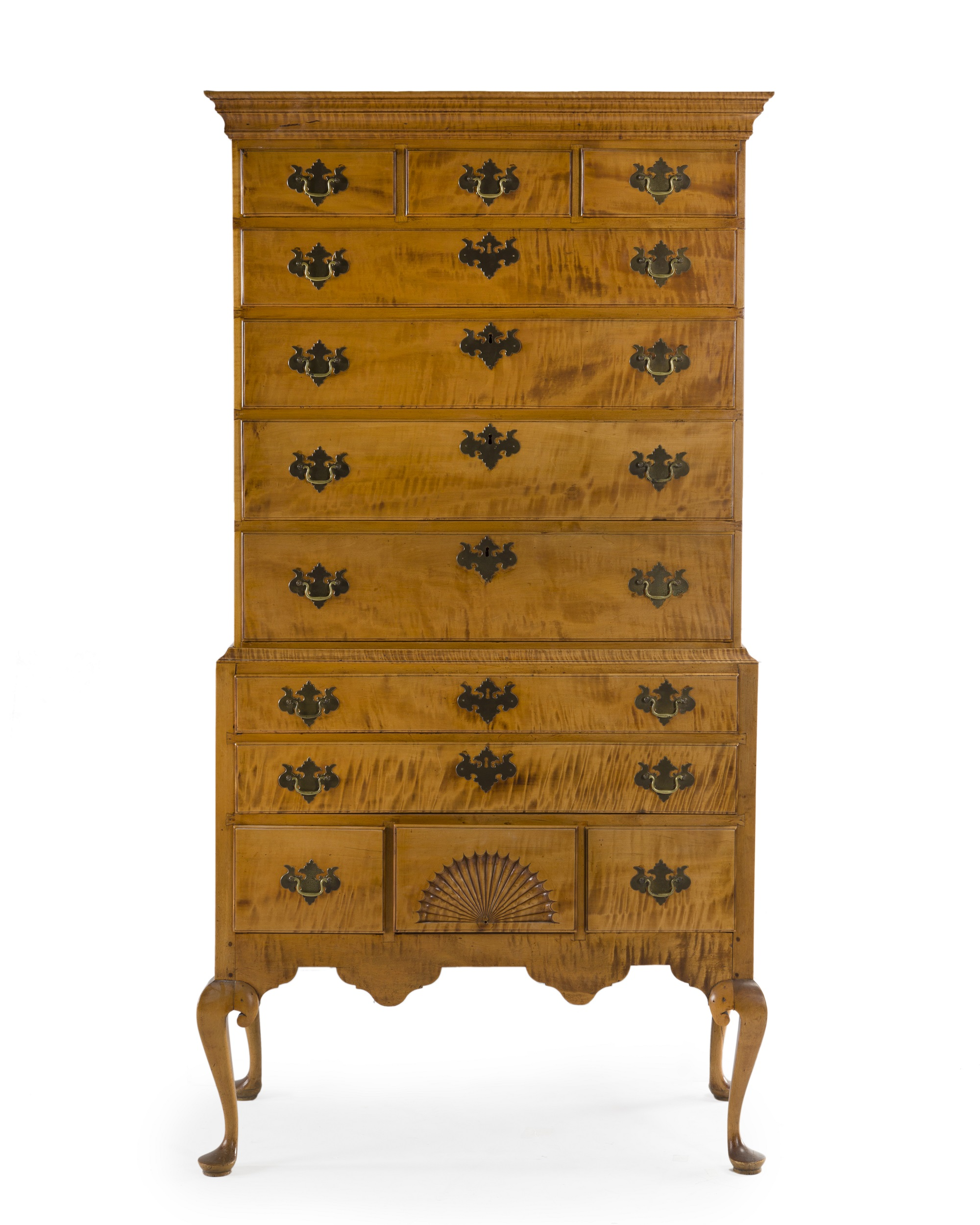 Lot 291, An American tiger maple chest on stand, est: $2,000-3,000