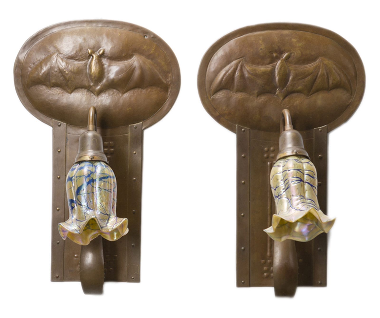 A pair of Glasgow School copper bat sconces