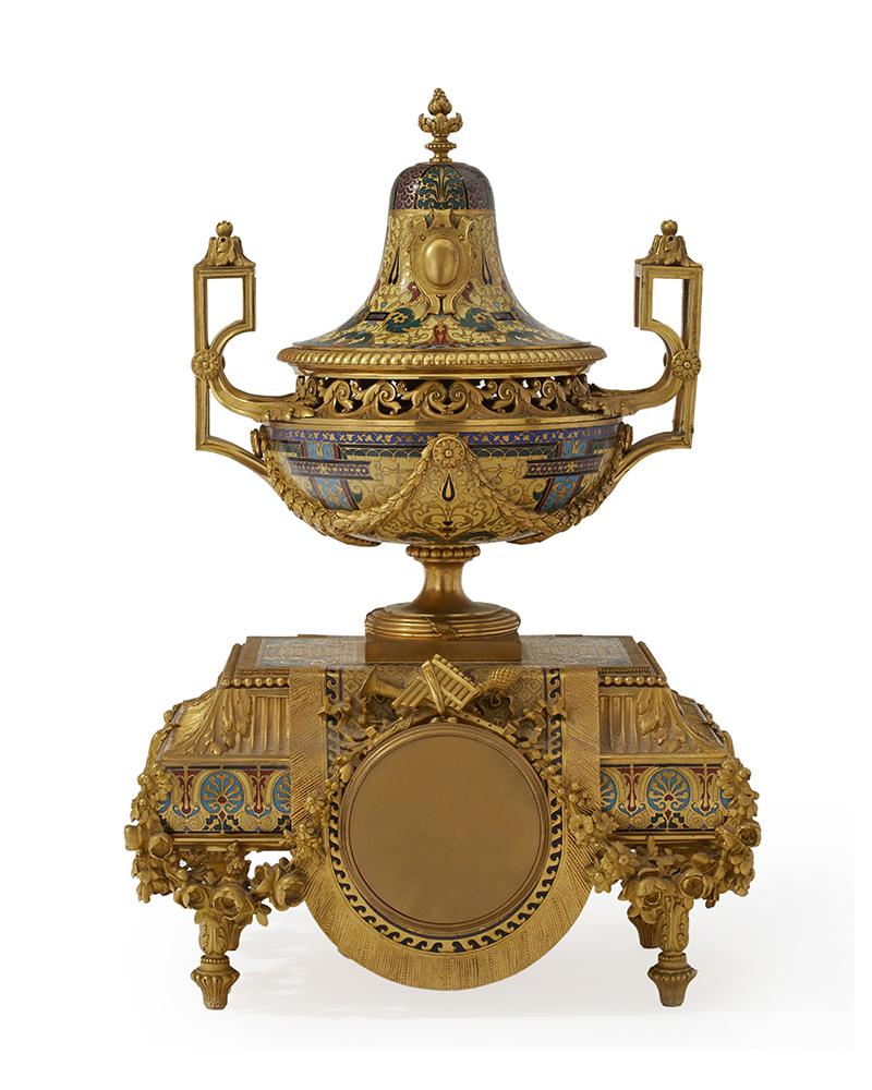 A gilt-bronze and champlevé clock and garniture set
