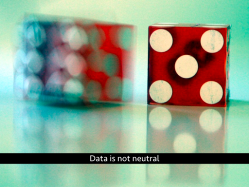 Blurry dice. Text: Data is not neutral