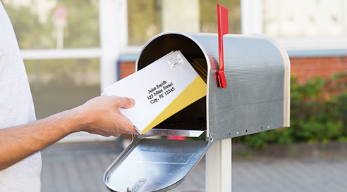 Example of someone putting enveloped the envelopes