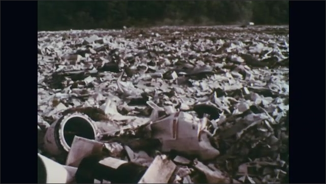 UNITED STATES 1970s ?????Trash slowly decomposes as a dump fills up.