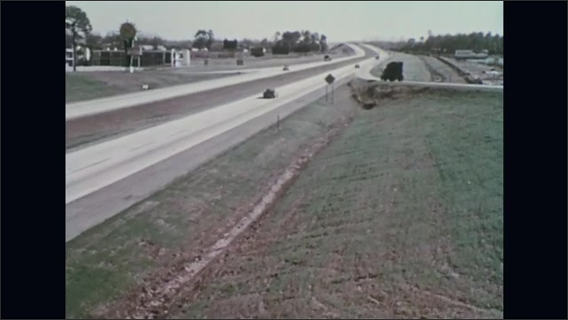 UNITED STATES 1970s – A previously barren land is transformed into a greenery adjacent to a highway system.