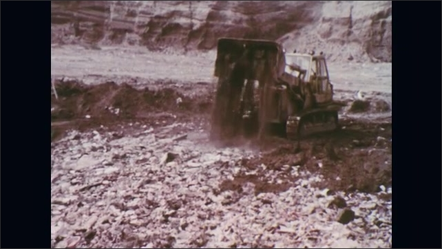 UNITED STATES: 1970s: Vehicle empties oil on top of rubbish in landfill site.