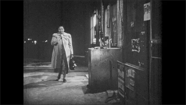 1950s: Midwife ties off umbilical cord on medical dummy. Woman sings and walks along dark sidewalks.