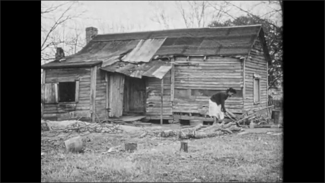 1950s: Horse and farmer pull plow along ground. Pregnant woman cuts wood in front of dilapidated home. Woman gathers wood and walks toward home.