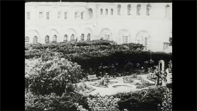 1910s: UNITED STATES: view across California building towards sea. Forbidden garden. Exhibit at fair.